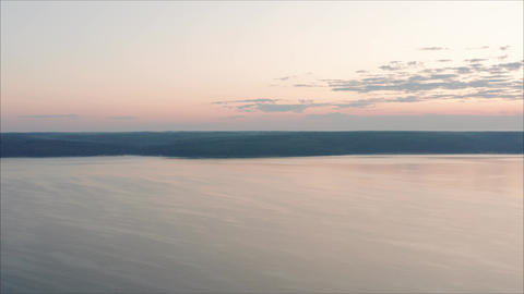 Aerial view of the dawn over the river in the fog. Dawn over water, from a Live Action