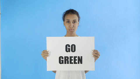 Afro-American Girl Activist With Save The Planet Poster on blue background Live Action