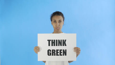 Afro-American Girl Activist With Think Green Poster on blue background Live Action