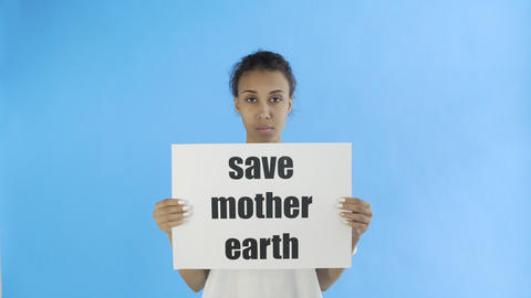 Afro-American Girl Activist With Save Mother Earth Poster on blue background Live Action