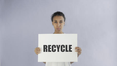 Afro-American Girl Activist With Recycle Poster on grey background Live Action