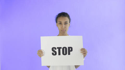 Afro-American Girl Activist With Stop Poster on Violet background Live Action
