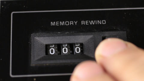 Finger resets to zero the readings of the old analog counter. Retro concept Live Action