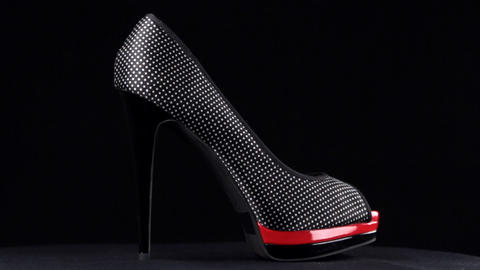 Rotation, shoes with high heels. Black high heel shoes on black background Live Action