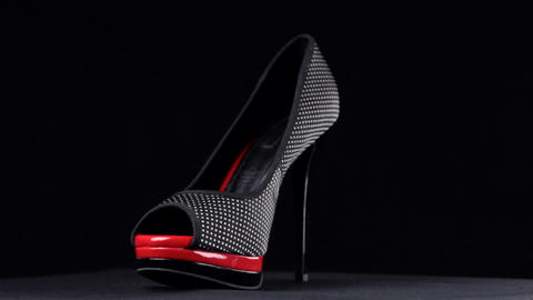Rotation, shoes with high heels. Black high heel shoes on... Stock Video Footage