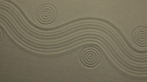 Unusual sand texture. Drawn waves and circles in the sand. With space Footage