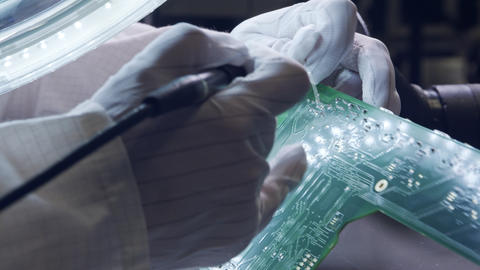 Close up of Manual soldering of electronic components on a board Live Action
