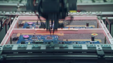 Automated SMT machine placing electronic components on a board Footage