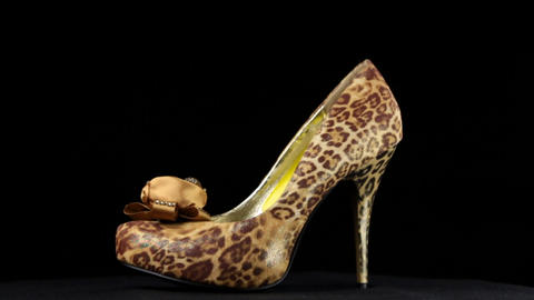 Rotation, shoes with high heels. Leopard high heel shoes Live Action