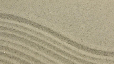 Unusual sand texture. Drawn lines and zigzags in the sand. With space Footage