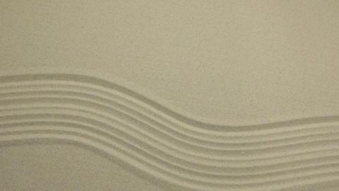 Unusual sand texture. Drawn lines and zigzags in the sand. With space Live Action
