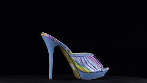 Rotation, high heel clogs. Blue high heel shoes on black background Live Action