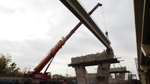 Scenery of silhouette of crane on big construction area with concrete beems Footage