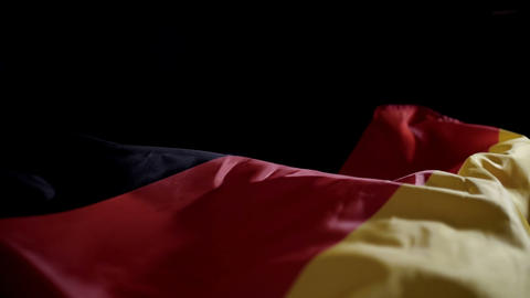Germany flag waving on black background with copyspace, slow motion Live Action