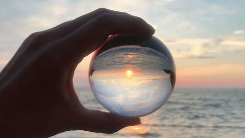 hand holding magic crystall ball over beautiful nature landscape, travel concept Footage