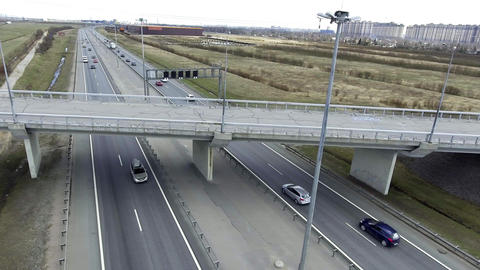 Scenery of grey roads, buildings, rooftops and bridges with cracked asphalt Footage