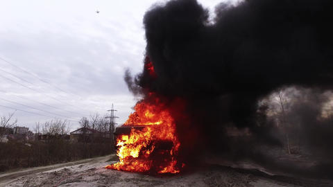 Enormous smoking flame of fire fully burns dirty old car... Stock Video Footage