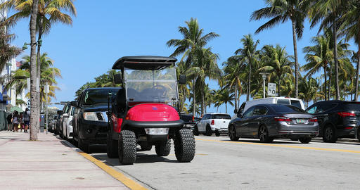 Small Electric Car Parked On Ocean Drive In Miami GIF