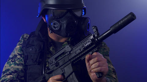 Soldier wearing gas mask holding rifle in smoke dolly motion Live影片