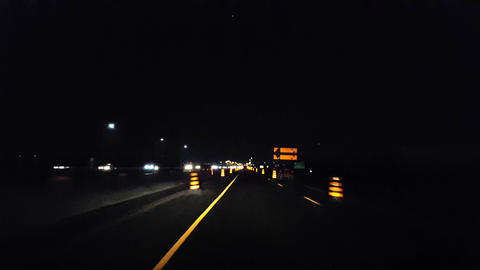 Driving Through City Highway Construction Zone During the Evening. Driver Point of View POV Urban Footage