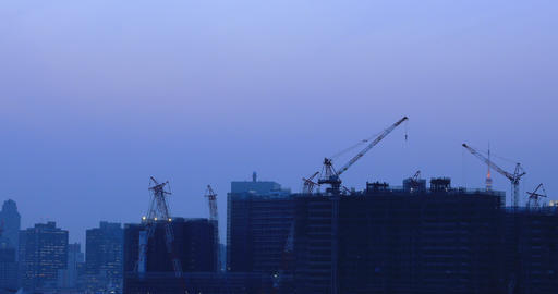 Cranes on the building at the under construction in Ariake Tokyo at dusk Footage