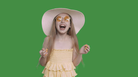 Happy young white caucasian girl with long hair yelow dress and summer hat Footage