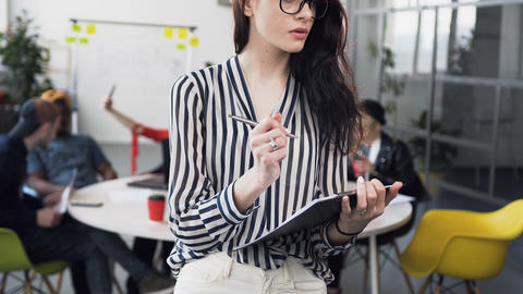 Portrait of attractive caucasian businesswoman in blouse with long hair working Footage