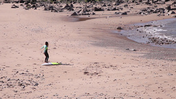 Surfer exercising on the beach before going to the water Footage