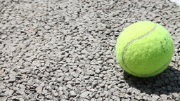 tennis ball on tennis court, slider shot Footage