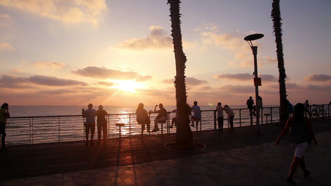 People watching the sunset on the Mediterranean seafront Footage