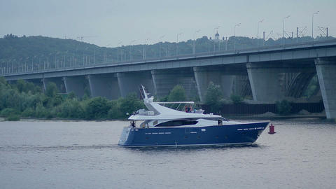 Luxury motor yacht sailing on river over cityscape Footage