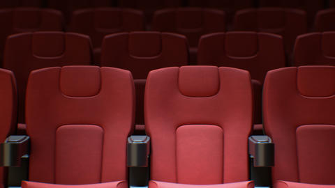 Flashing Light from the Cinema Screen on the Red Chairs in Cinema Hall Seamless Live Action