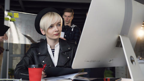 Close-Up of portrait of busy young business woman working at modern office using Footage