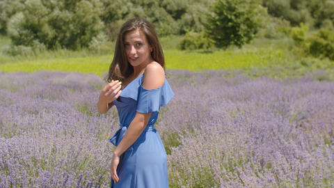 Playful pretty woman beckoning in summer nature Footage