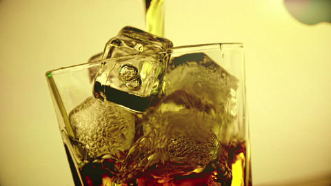 barman pouring whiskey in the glass with ice cubes on wood table background, focus on ice cubes, Footage