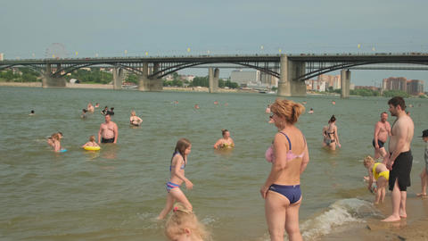 Summer vacation on the beach. tourists swim in the sea water. crowds of people Footage