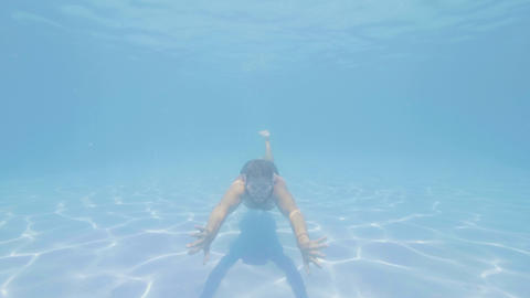 Man is swimming on the pool in clear blue water,…, Live Action
