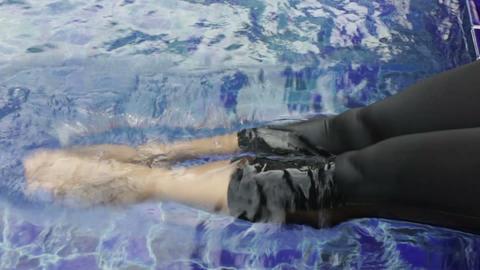 Female having fun in swimming pool Footage
