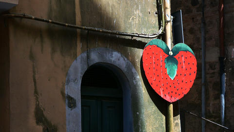 sign of a huge strawberry, culinary symbol of Nemi Footage