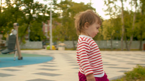 Very active little girl on the playground Footage