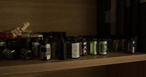 Used 35mm photo film canisters of different brands in a photo lab Live Action