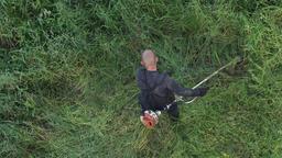 Gardener cutting grass in garden, manual gasoline lawn trimmer Footage