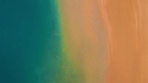 Aerial view of the golden sand of the beach Las Teresitas and turquoise water of Footage