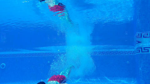 Underwater shooting as a man dives into the pool and…, Live Action