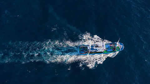 Top view of a fishing boat sailing in the Atlantic Ocean Footage