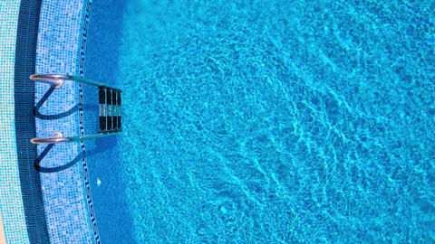Top view from a drone over the ladder and surface of the pool Footage