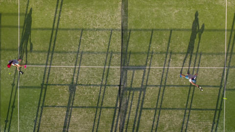 View from the height of the tennis court where people warm up before the game Footage