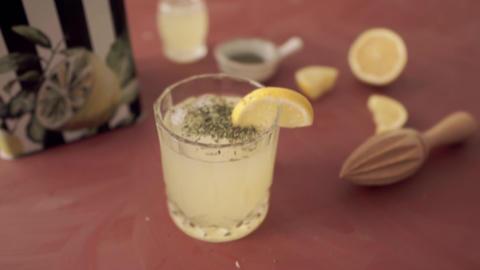 Fresh lemonade, lemon and ice in glass Live Action