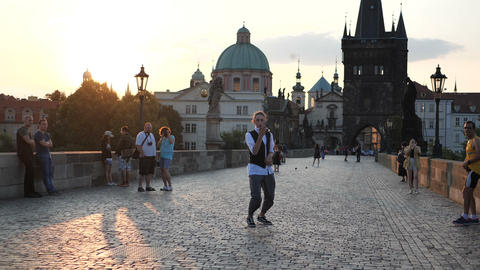 4k - The cool boy dancing hip hop on the bridge, lit by the sun, slow motion Footage