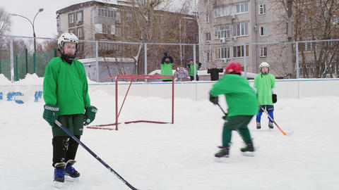 little hockey player attacks gate passing protection on rink Footage